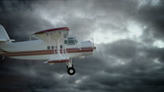 The antonov An-2 bi-plane fly in bad weather. Old white retro plane. Stock Footage