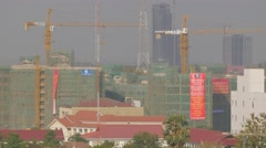 Construction site with crane lifting ,Vientiane,Laos Stock Footage