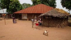 African village scenario with people and goat in Guinea Bisseau Stock Footage