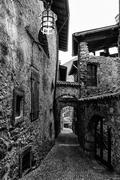Stock Photo of Narrow alley in a medieval village in Italy.