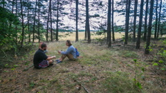 Olsztyn, POLAND- AUGUST 25, 2015 : Family (parents and son) resting in forest Stock Footage