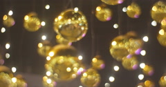 Golder Decorative Balls Shining Chtistmas Toys Hanging on a Cable Lamp Garlands Stock Footage