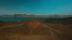 Stock Video Footage of Wide Panoramic Shot of the Volcanic Island of Thirassia in Santorini Greece