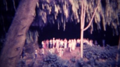 1973: Tourists attracted to subterranean tropical cave entrance. HONOLULU, - stock footage