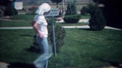 1972:  Religious teenager visits interstate rest stop keep dogs on leash sign. Stock Footage