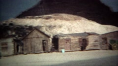 1973: Ghost town wagon trail log cabins and western railroad trains. RENO, Stock Footage