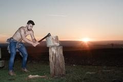 The stylish lumberjack at work. - stock photo