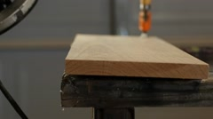 A wood worker using a router to add detail - stock footage