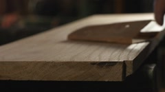 A carpenter - wood worker sanding a board by hand Stock Footage