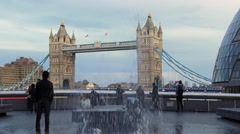 Tower bridge in London through jets of water Stock Footage