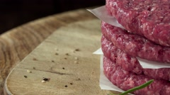 Raw Burger Meat (rotating, loopable, 4K) Stock Footage