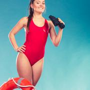Stock Photo of Lifeguard woman on duty with ring buoy lifebuoy.