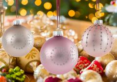 Three Christmas decorations on strings - stock photo