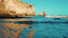 Low Angle Beach Cliff Shore Shot in the Algarve, Portugal Stock Footage