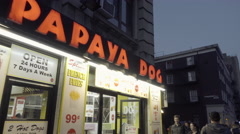 Papaya Dog in West Village panning to 6th Avenue traffic at night in NYC 4K Stock Footage