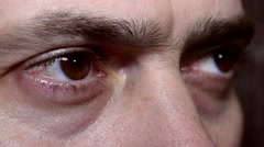 Eyes of the man blink looking forward - stock footage