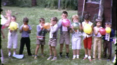 Cute Kids Blowing Up Balloons Blow Children 1960s Vintage Film Home Movie 9135 Stock Footage
