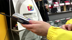 """Broadway Camera""""s black friday sale with shopper paying item by credit card - stock footage"""