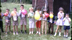 Cute Kids Blowing Up Balloons Blow Children 1960s Vintage Film Home Movie 9136 - stock footage