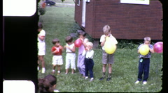 Cute Kids Blowing Up Balloons Blow Children 1960s Vintage Film Home Movie 9137 - stock footage