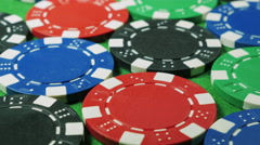 Red dices and casino chips on green cloth background. Dolly shot. Double three. Stock Footage