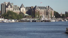Water Taxi and Empress Hotel at Victoria Harbor Stock Footage