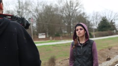 Cameraman Shoots Teen Girl Singing for Music Video - stock footage