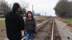 Cameraman Shoots Teen Girl Singing for Music Video Stock Footage