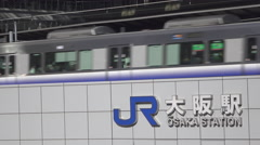 Train Arriving at Osaka Station in Japan Stock Footage