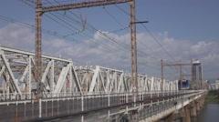 Trains on Yodo River Bridge in Osaka, Japan - stock footage