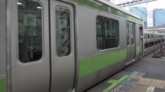 Japan Rail Yamanote Line Train Arriving at Station - stock footage
