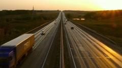 cars traveling on the highway road at sunset, 4k - stock footage