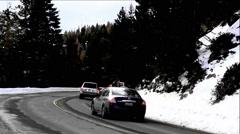 Evening Traffic On Snowy Mountain Pass Stock Footage