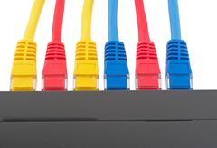 LAN network switch with ethernet cables Stock Photos