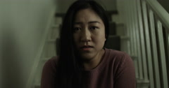 A young Asian woman having relationship problem. Shot on RED Epic. Stock Footage