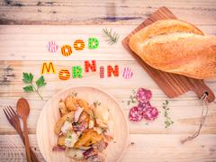 Breakfast  setup on wooden table with colourful Good Morning words. - stock photo