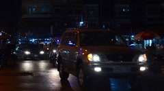 Traffic flow on the night streets in the evening view - stock footage