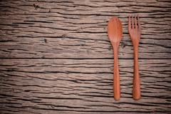 Fork and spoon on grunge wood food background concept ,menu design and advert Stock Photos