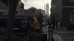 Freedom Tower with tourism bus driving Greenwich Village street early evening NY Stock Footage
