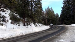 Traffic On Snowy Mountain Pass Road Stock Footage