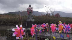 Pinwheels and Statue at Ozoresan in Japan Stock Footage