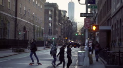 Man skateboarding on Washington Square and West 4th Street with Freedom Tower NY Stock Footage