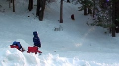 Woman Watching Children Playing In Snow Stock Footage