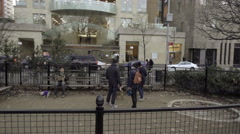 panning shot of Washington Square Park small dog run behind fence cold fall NYC - stock footage