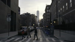People crossing quiet intersection on Washington Square South, crosswalk NYC Stock Footage