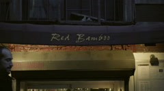 Red Bamboo vegan restaurant - slow zooming out on front entrance and sign in NYC Stock Footage