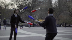 Talented jugglers playing catch with pins Washington Square Park messing up NYC Stock Footage