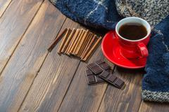 Coffee and blanket on wooden floor, warm Stock Photos