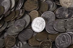 Coin ruble among many other coins Stock Photos