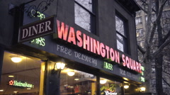 Washington Square Diner sign in early evening slow zooming out - exterior NYC Stock Footage